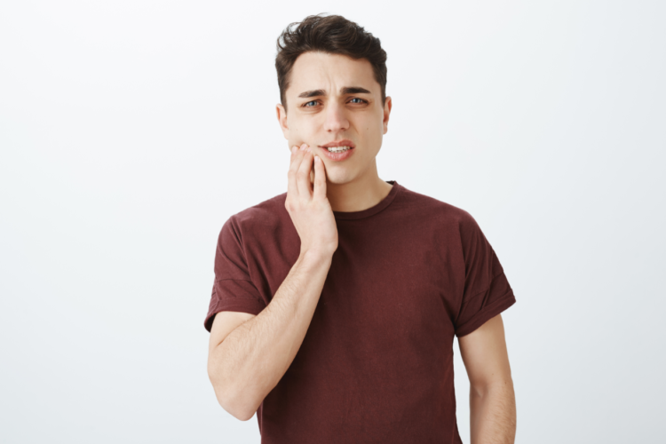 guy with tooth pain